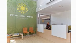 Dental practice receptionist office branded wall
